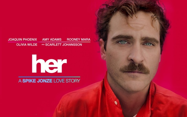 "A movie poster advertising Spike Jonze's film ""Her."" On the right side of the image is actor Joaquin Phoneix staring seriously into the camera. He wears a bright coral shirt. The background is a bright coral similar to his shirt. On the left, the image reads: ""Joaquin Phoenix, Amy Adams, Rooney Mara, Olivia Wilde, and Scarlett Johansson."" Beneath the actors' names is the film title, ""Her,"" in lowercase letters. The tagline beneath the film title reads ""A Spike Jonze Love Story."""