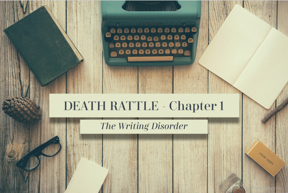 "An image of a wooden tabletop from above. In the center, the image reads: ""Death Rattle: Chapter 1. The Writing Disorder."" Around the text lay a blue typewriter, an open empty notebook, a box of film slides, a pair of glasses, an old book, and a pinecone."